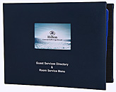 Padded guest directory with die-cut window to hold 4 color photo with silver foil stamped logo.