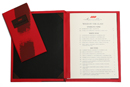 silk screened menu cover with die-cut window to hold 2 color silk screened logo. Matching silk screened check presenter.